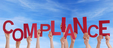 Hands Holding Compliance in the Sky Royalty Free Stock Image