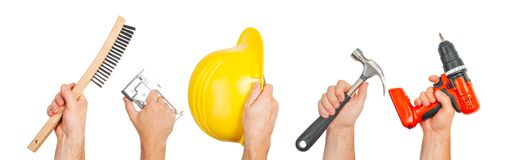 Hands holding construction tools isolated on white background. Hand tools. Hands holding construction tools isolated on white background royalty free stock image