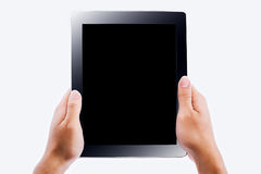 Hands holding contemporary generic tablet. Pc with blank screen. Isolated on white Stock Photos
