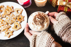 Hands Holding Cream Cappuccino and Gingerbread Stock Image