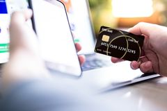 Hands holding credit card and making online shopping Stock Photography