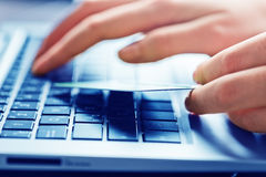 Hands holding a credit card and using laptop Royalty Free Stock Photo