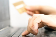 Hands holding a credit card and using laptop computer for online shopping. Credit Card Online Technology Shopping. Close up of fem stock image