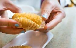 Hands holding crispy durian fruit dessert Royalty Free Stock Photo