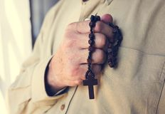 Hands holding cross prayer faith in christianity religion Royalty Free Stock Images