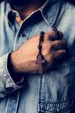 Hands holding cross prayer faith in christianity religion stock photos