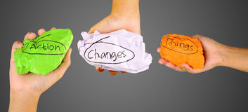 Hands Holding Crumpled Paper With Action Changes Things Writing Royalty Free Stock Image