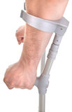 Hands holding crutch Stock Images