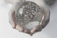 Hands holding a crystal ball Stock Photography