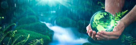 Free Hands Holding Crystal Earth In Tropical Rainforest Royalty Free Stock Image - 214343346
