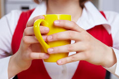 Hands holding cup of coffee Stock Photos