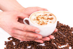 Hands holding a cup of coffee Stock Images
