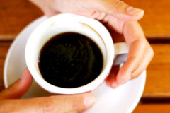 Hands holding a cup of coffee Royalty Free Stock Image