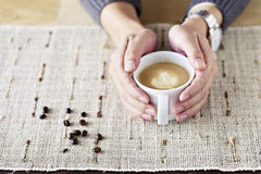 Hands holding cup of coffee Royalty Free Stock Photos