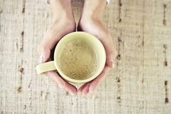 Hands holding cup of coffee Stock Image
