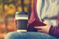 Hands holding cup of coffee and phone. Female hands holding cup of coffee and phone. Vintage photo royalty free stock images