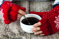 Hands holding a cup of coffee Stock Photography
