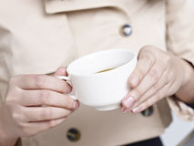 Hands holding a cup of coffee Stock Image