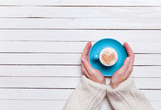 Hands holding cup Stock Image