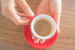 Hands holding cup of hot coffee Stock Photo