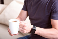 Hands holding cup of tea Royalty Free Stock Photos