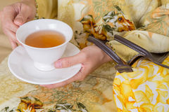 Hands Holding Cup Of Tea II Stock Images
