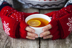 Hands holding a cup of tea Royalty Free Stock Photography