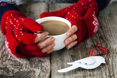 Hands holding a cup of tea Royalty Free Stock Image