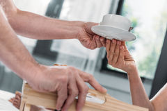 Hands holding cup of tea on saucer Royalty Free Stock Photography