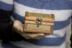 Hands holding a decorative wooden box Royalty Free Stock Images
