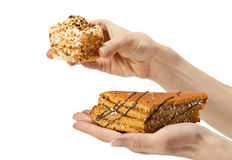 Hands holding delicious cakes Royalty Free Stock Photos