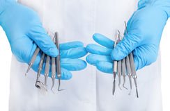 Hands holding dental instruments Stock Photography