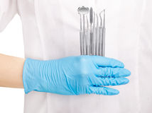 Hands holding dental instruments Royalty Free Stock Images
