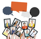 Hands Holding Devices with People's Faces and Speech Bubbles Royalty Free Stock Image