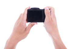 Hands holding digital camera with blank screen isolated on white Royalty Free Stock Photo