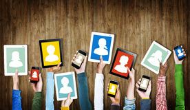 Hands Holding Digital Devices with Avatar Symbols Royalty Free Stock Photography