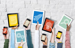 Hands Holding Digital Devices with Startup Concepts. Group of Hands Holding Digital Devices with Startup Concepts Stock Photography