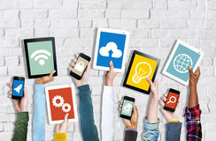 Hands Holding Digital Devices with Various Symbols Royalty Free Stock Photography