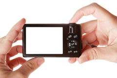 Hands holding digital photo camera Stock Image