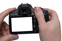 Hands holding digital photo camera. Isolated on white background stock images
