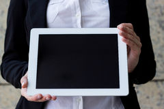 Hands holding a digital tablet Royalty Free Stock Images