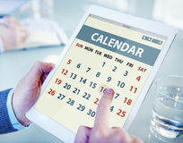 Hands Holding Digital Tablet Calendar Stock Image