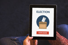 Hands holding digital tablet computer with online voting concept Royalty Free Stock Photo
