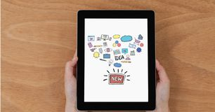 Hands holding digital tablet with new idea icons. Digital composite of Hands holding digital tablet with new idea icons Stock Images