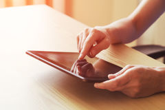 Hands holding digital tablet Stock Photo