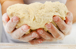 Hands holding a  dough Royalty Free Stock Image