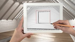 Hands holding and drawing on tablet showing modern empty interior sketch. Real finished interior with no people and furniture in. The background, architecture royalty free stock photography