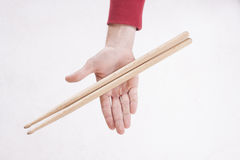 Hands holding drumsticks royalty free stock image