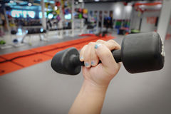 Hands holding dumbbells in sport club or gym and fitness Stock Photo