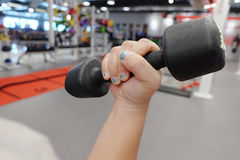 Hands holding dumbbells in sport club or gym and fitness Royalty Free Stock Image
